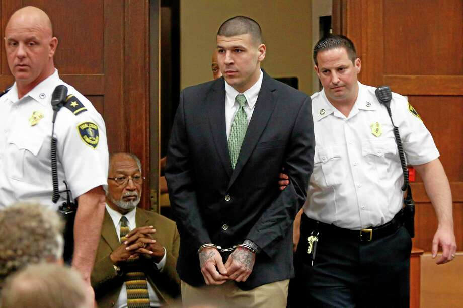 Former New England Patriots tight end Aaron Hernandez is let into the courtroom to be arraigned on homicide charges at Suffolk Superior Court in Boston on Wednesday. Hernandez pleaded not guilty in the shooting deaths of Daniel de Abreu and Safiro Furtado. He already faces charges in the 2013 killing of semi-pro football player Odin Lloyd. Photo: Dominick Reuter — The Associated Press   / Pool, Reuters