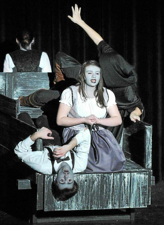 """Freshmen Brandon Butler as """"Dr. Frankenstein"""" and Jamie Hribko as """"Inga"""" work on a scene as students at East Haven High School work on their upcoming production of """"Young Frankenstein."""" Photo: Peter Casolino — New Haven Register"""