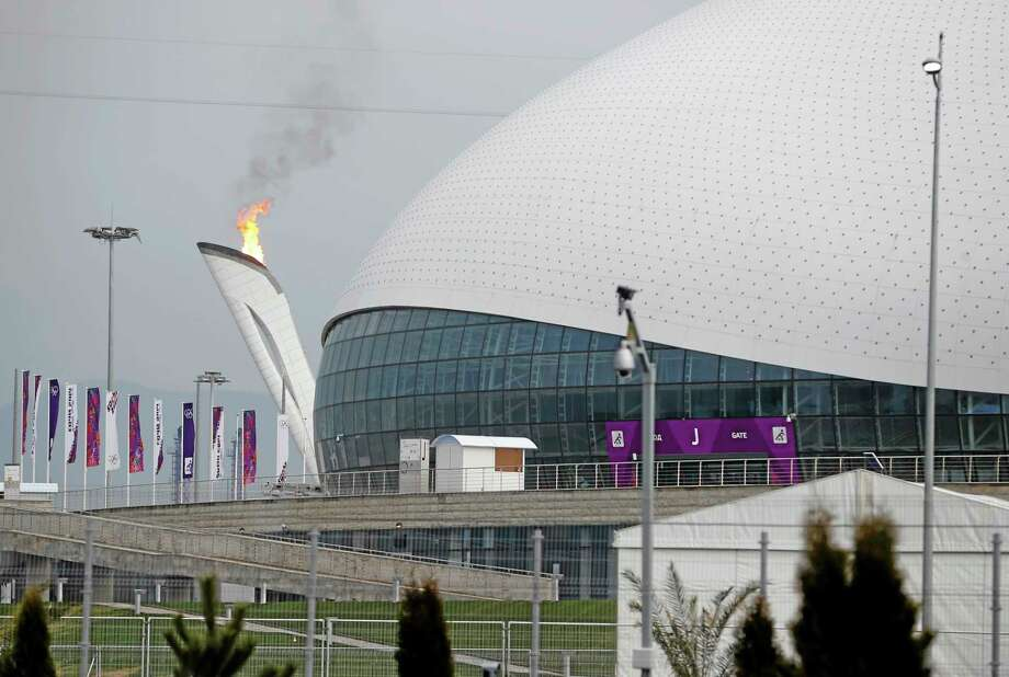 The Olympic flame is lit during a test next to the Bolshoy Ice Dome before the start of the 2014 Winter Olympics, Wednesday, Jan. 29, 2014, in Sochi, Russia. (AP Photo/Pavel Govolkin) Photo: AP / AP
