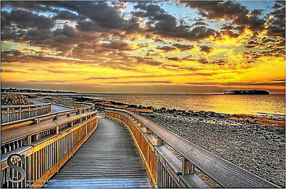 Photographer JJ Richards' shot of a Milford beach boardwalk is among those that now graces the city's train station. Photo: Journal Register Co.