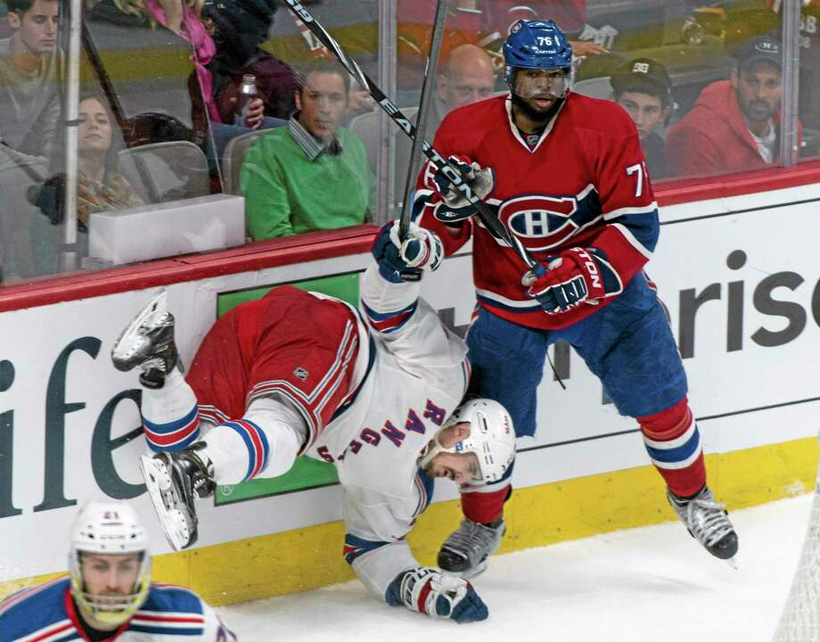 The Rangers' Chris Kreider falls in front of the Canadiens' P.K. Subban during the third period of Game 5 of the Eastern Conference finals on Tuesday night in Montreal. New York lost 7-4. Photo: Paul Chiasson — The Canadian Press   / The Canadian Press