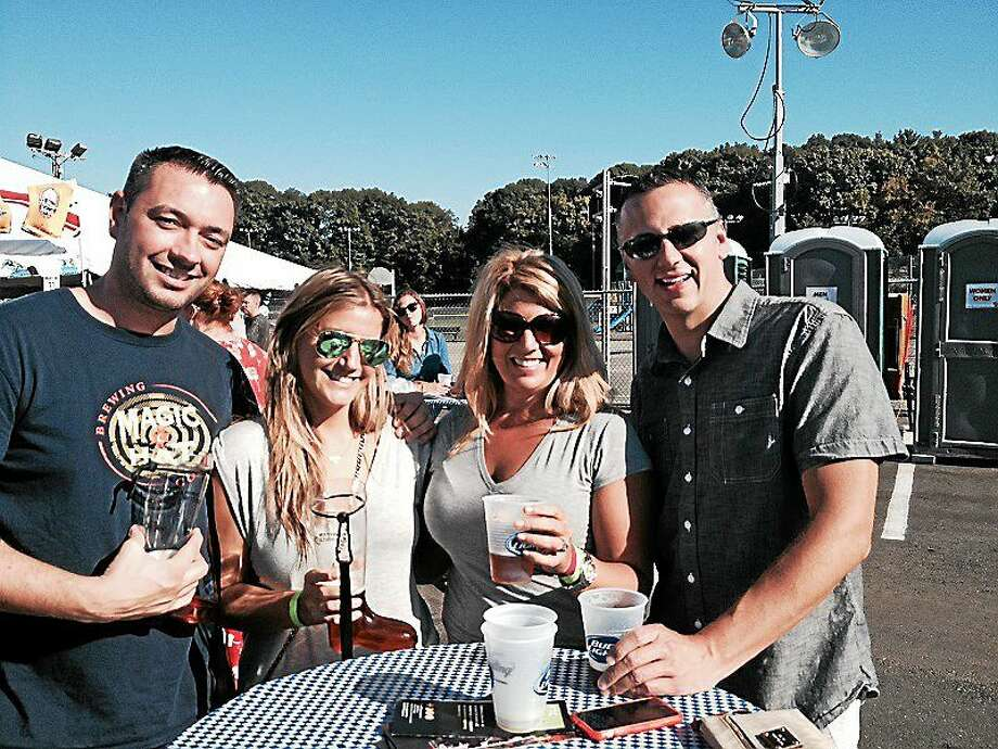 From Left to right: Alex Perro, his girlfriend, Ashley Karpel, and Amy Borysewicz and her boyfriend, Jonathan Gibbs, became fast friends when they met at Devon Rotary Club's Oktoberfest Saturday. Photo: (Pam McLoughlin — New Haven Register)