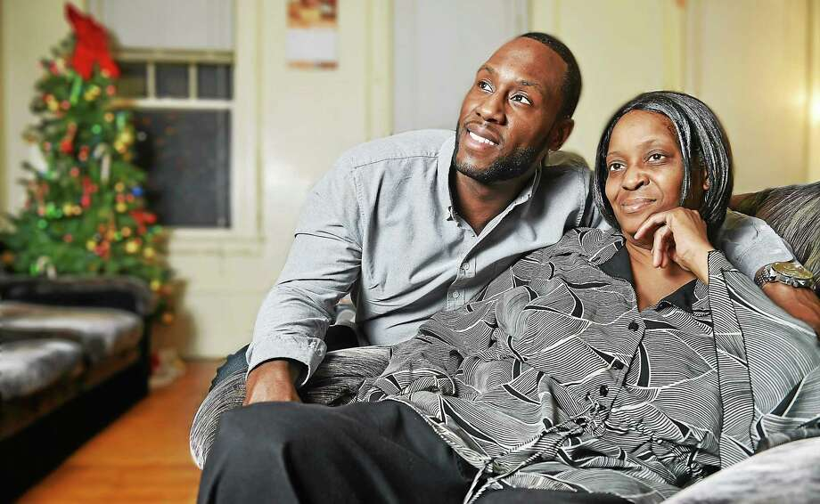 Everett, Mass. resident Terrell Lewis with his mother Angela Parker in her New Haven home together for the Thanksgiving holiday Wednesday evening, November 26, 2014. Photo: (Catherine Avalone — New Haven Register)    / New Haven RegisterThe Middletown Press