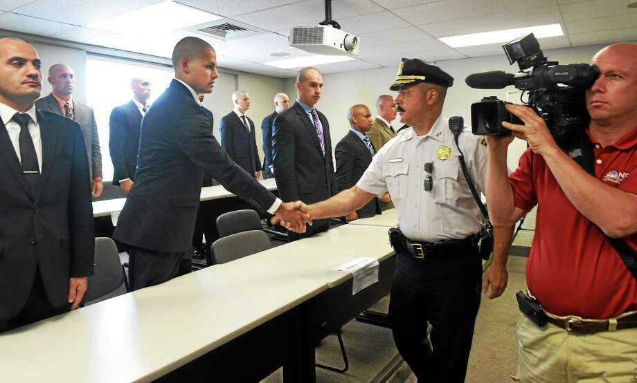 New Haven police Assistant Chief L. Casanova congratulates recruits Tuesday at the New Haven Police Academy. Photo: Peter Hvizdak — New Haven Register   / ©Peter Hvizdak /  New Haven Register