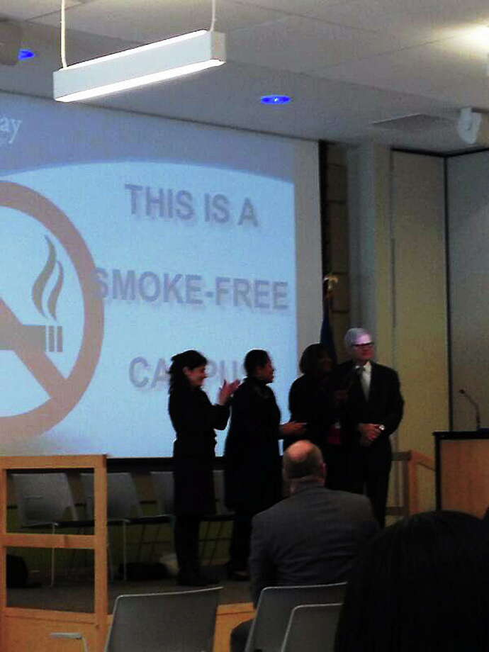 Gateway Community College President Dorsey Kendrick receives the official recognition of GCC's now smoke-free campus from, from left, U.S. Department of Health and Human Services Regional Health Administrator (RHA) and Deputy RHA Betsy Rosenfeld; state Department of Public Health Commissioner Jewel Mullen; and Board of Regents for Higher Education President Gregory Gray Wednesday in New Haven. Photo: NEW HAVEN REGISTER
