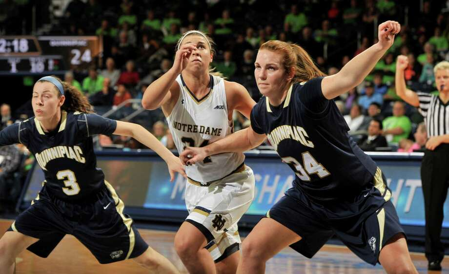 Notre Dame's Hannah Huffman battles for position with Quinnipiac's Adily Martucci, left, and Val Driscoll in the first half of the Fighting Irish's 112-52 win on Tuesday in South Bend, Ind. Photo: Joe Raymond — The Associated Press   / FR25092 AP