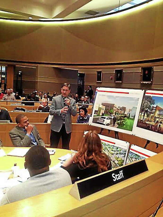 Architect Christopher Bockstael describes Continuum project. Photo: Mary O'Leary/New Haven Register