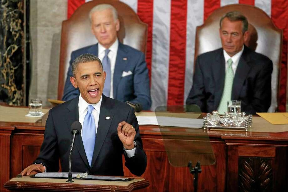 Vice President Joe Biden and House Speaker John Boehner of Ohio listen as President Barack Obama gives his State of the Union address on Capitol Hill in Washington, Tuesday Jan. 28, 2014. (AP Photo/Charles Dharapak) Photo: AP / AP