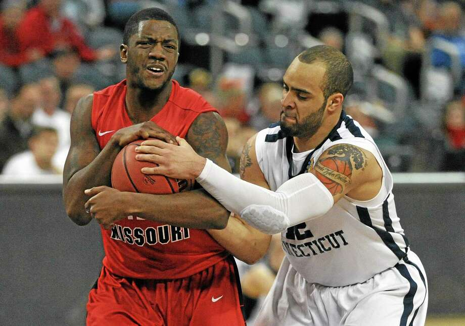 Southern Connecticut State's Tylon Smith ties up Central Missouri's T.J. White during the second half of the Owls' 98-88 loss Wednesday afternoon in the national quarterfinals of the NCAA Division II tournament at the Ford Center in Evansville, Ind. Photo: Jason Clark — The Evansville Courier & Press   / The Evansville Courier & Press