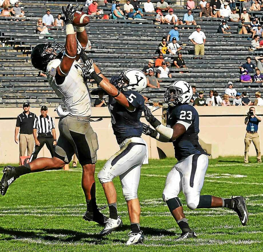 Cole Champion (5) is the next captain of the Yale football team. Photo: Peter Hvizdak — Register File Photo