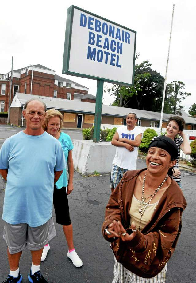 From left, Mark Barone, Diane Manville, David Hernandez, Laura Gonzalez (front) and Nicole Fawell, residents at the Debonair Beach Motel in West Haven, are waiting to see what will become of their home. Photo: Peter Hvizdak — New Haven Register    / ©Peter Hvizdak /  New Haven Register