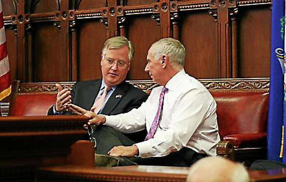 House Speaker Brendan Sharkey talks with, Mark Ojakian, the governor's chief of staff as the House debates minimum wage. Photo: Hugh McQuaid/CTNewsJunkie.com