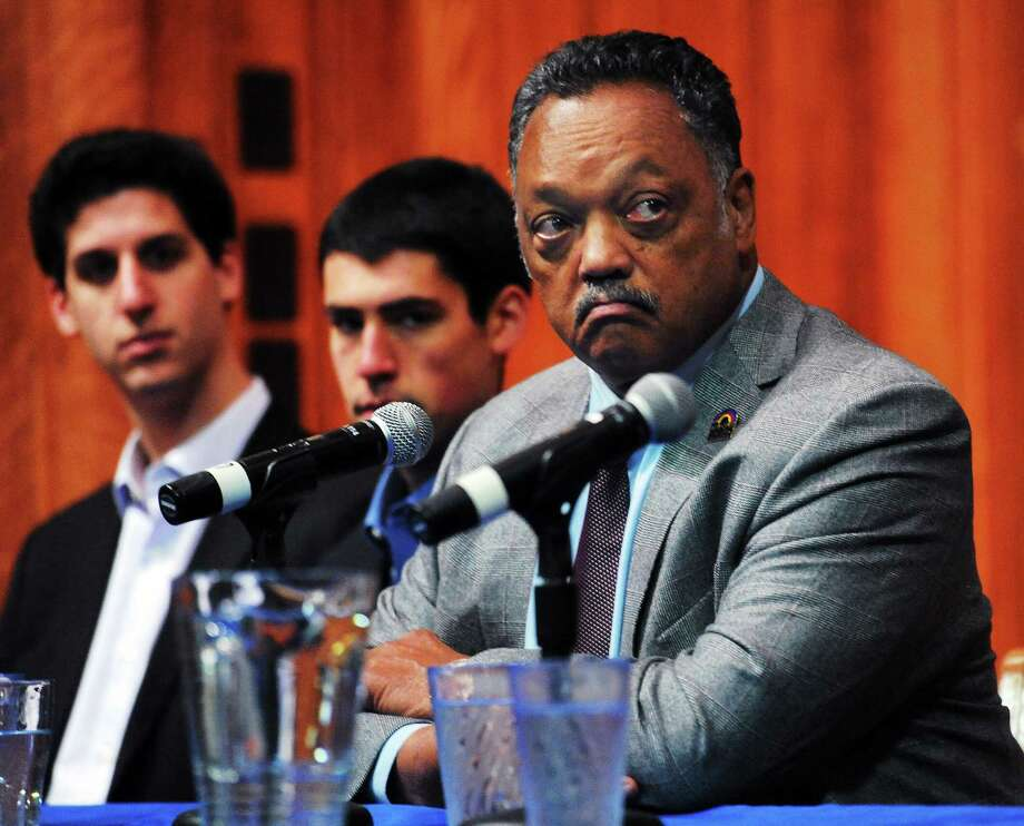 The Rev. Jesse Jackson takes questions from students at an event at Yale University Wednesday, including the editors-in-chief of the Yale Politic, Justin Schuster, left, and Eric Stern, center. Photo: Mara Lavitt — New Haven Register      / Mara Lavitt