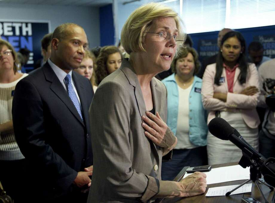 Democratic U.S. Senate candidate Elizabeth Warren, right, takes questions from members of the media as Mass. Gov. Deval Patrick, left, looks on during an event at Warren's campaigns headquarters, in Somerville, Mass., Wednesday, May 30, 2012, during which Patrick formally endorsed Warren in her campaign for the Senate seat. (AP Photo/Steven Senne) Photo: AP / AP