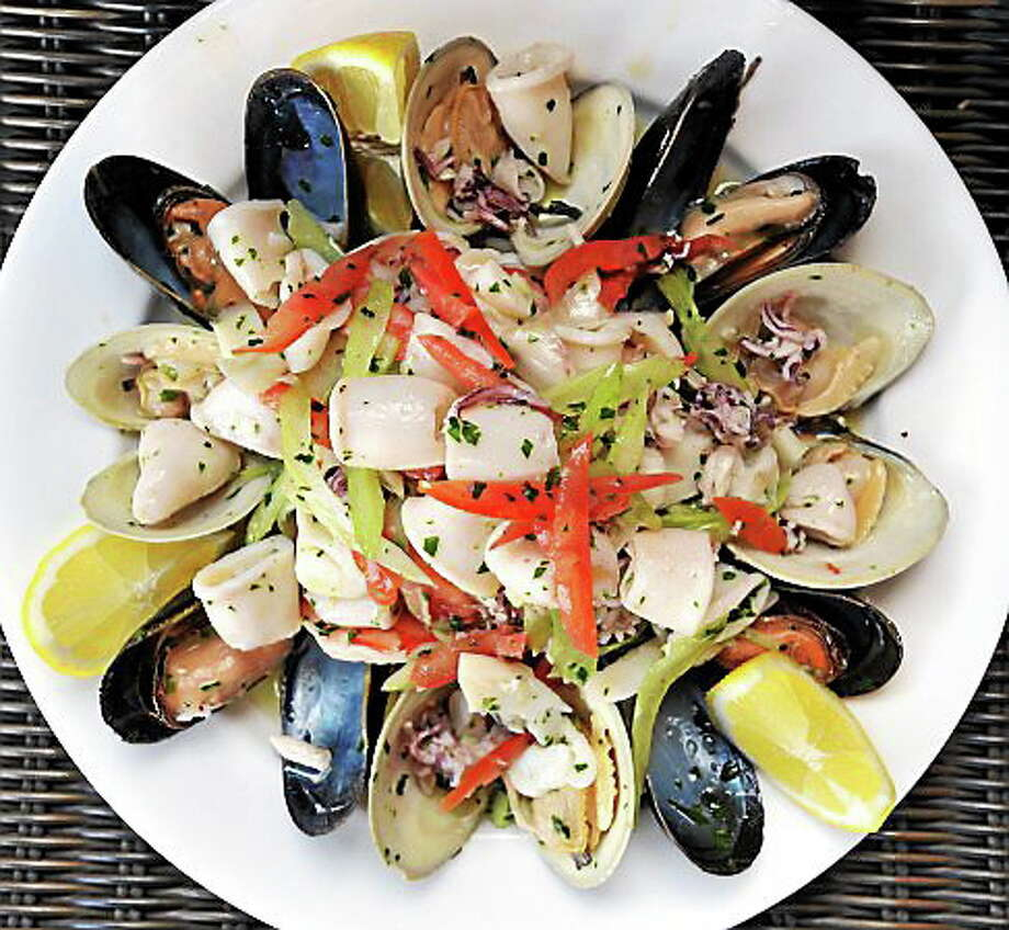 (Mara Lavitt — New Haven Register)   March 10, 2014 New Haven  Seafood salad: calamari, mussels, shrimp, clams, cuttlefish, onion, celery, tomatoes, and fresh lemon. Adriana's restaurant on Grand Avenue.  mlavitt@newhavenregister.com Photo: Journal Register Co. / Mara Lavitt