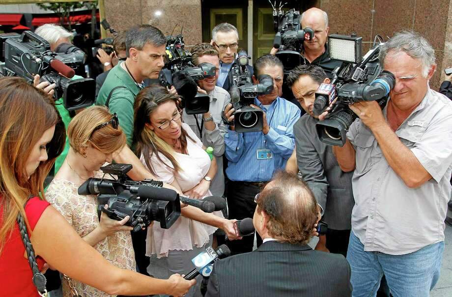 Max Blecher, attorney for Los Angeles Clippers owner Donald Sterling, talks to reporters during a break in the Clippers-Sterling trial in Los Angeles on Monday. Photo: Nick Ut — The Associated Press   / AP