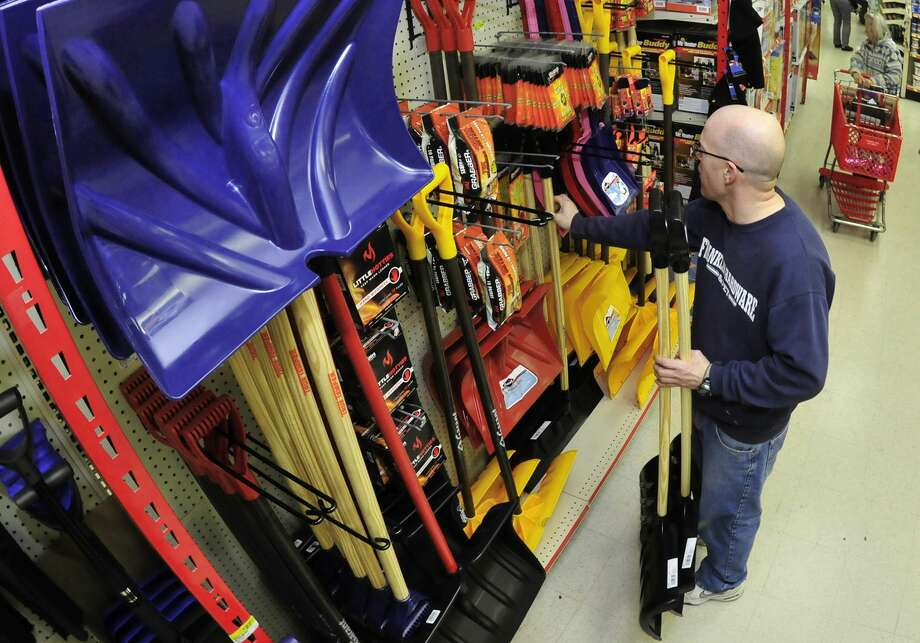 Barry Burkholder, assistant manager at Franklin Hardware and Pet Store, Chambersburg, Pa., checks his supply of snow shovels and other items Monday, November 24, 2014  in preparation for a Wednesday snowstorm that could bring a foot of snow to the region. Photo: Markell DeLoatch — The Associated PRess   / PUBLIC_OPINION