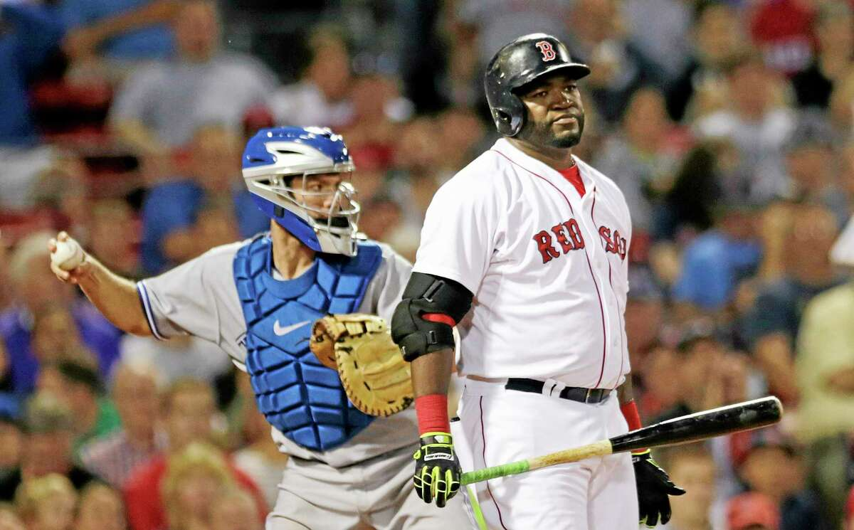 Boston Red Sox designated hitter David Ortiz reacts after striking out against Toronto Blue Jays starting pitcher R.A. Dickey in the fourth inning Monday. The Red Sox 14-1.