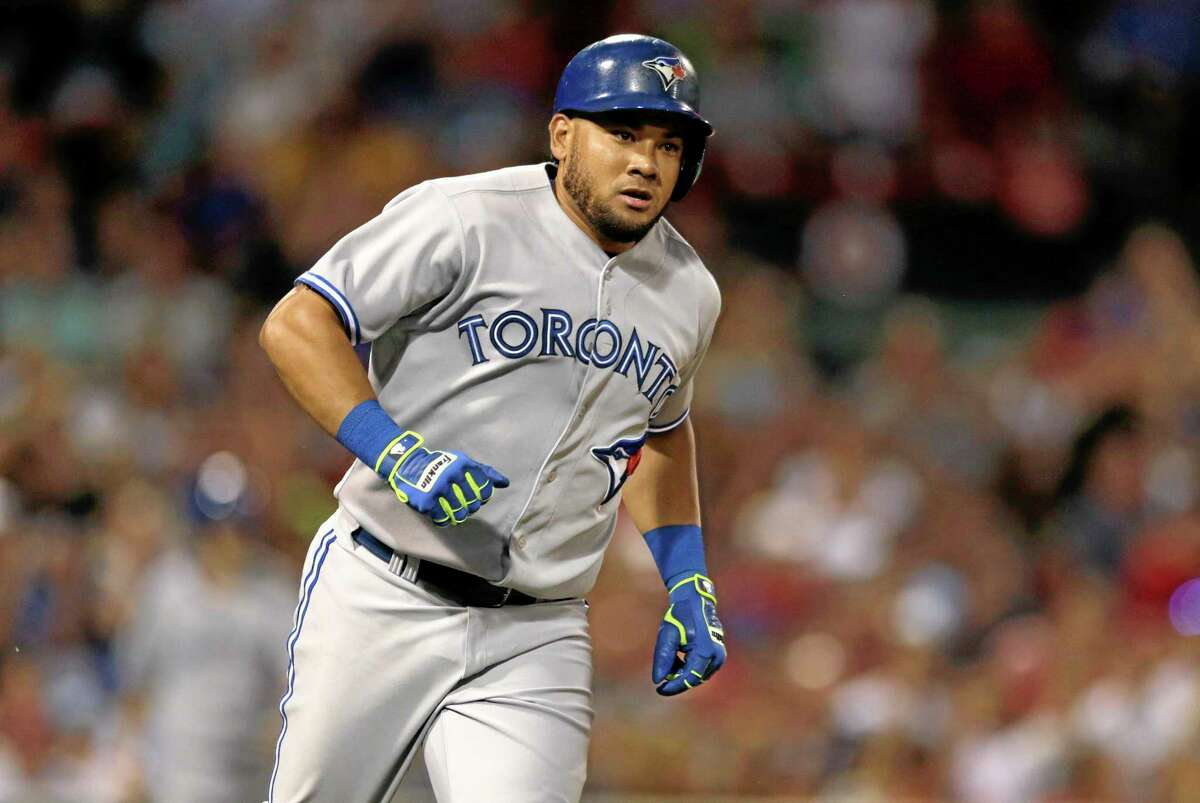 Charles Krupa — The Associated Press The Blue Jays' Melky Cabrera heads down the first base line on his second two-run, home run of the game against the Boston Red Sox on Monday.
