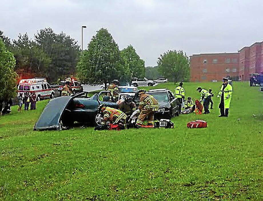 East Haven High School's Students Against Destructive Driving (SADD) chapter staged a mock prom night car crash Wednesday. Photo: Evan Lips — New Haven Register