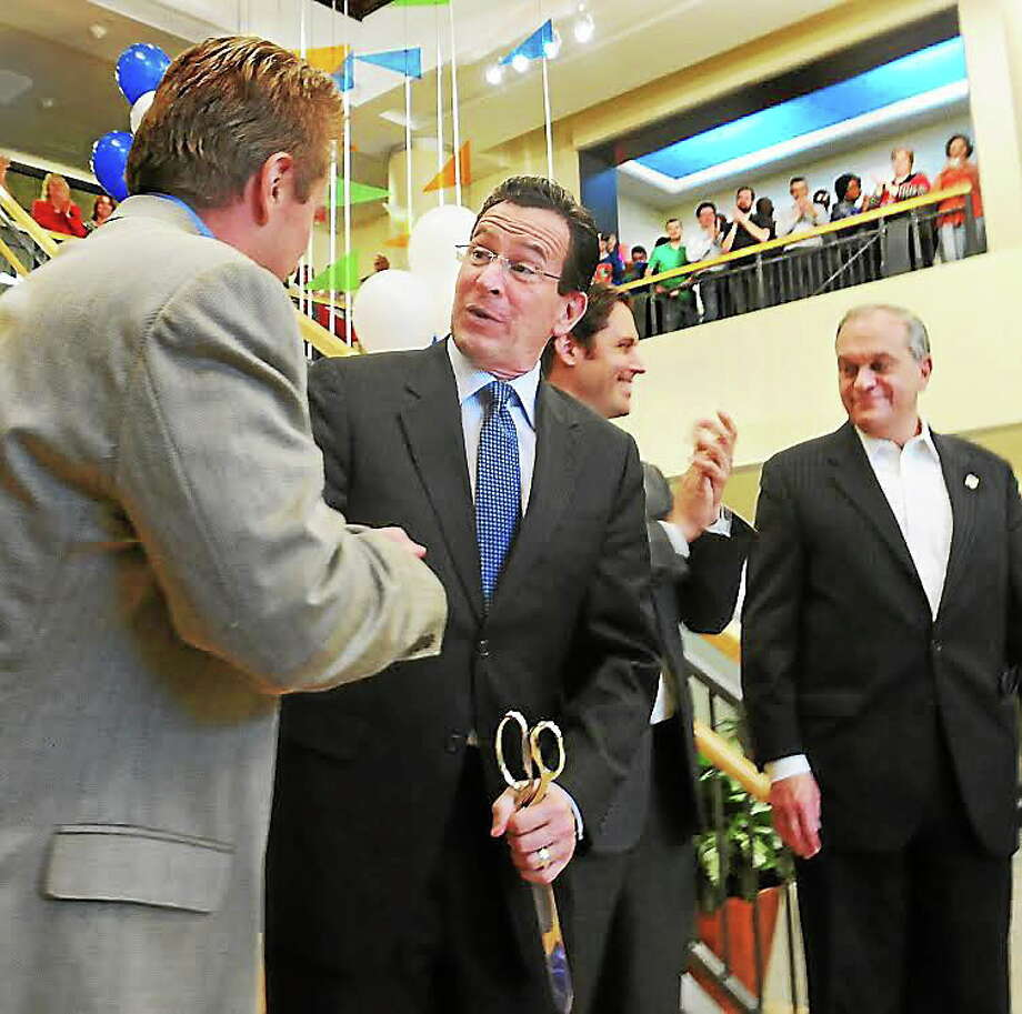 From left, Mark Volchek, chairman and CEO of Higher One Holdings; Gov. Dannel P. Malloy; Miles Lasater, COO of Higher One; and former New Haven Mayor John DeStefano Jr. Photo: New Haven Register File Photo