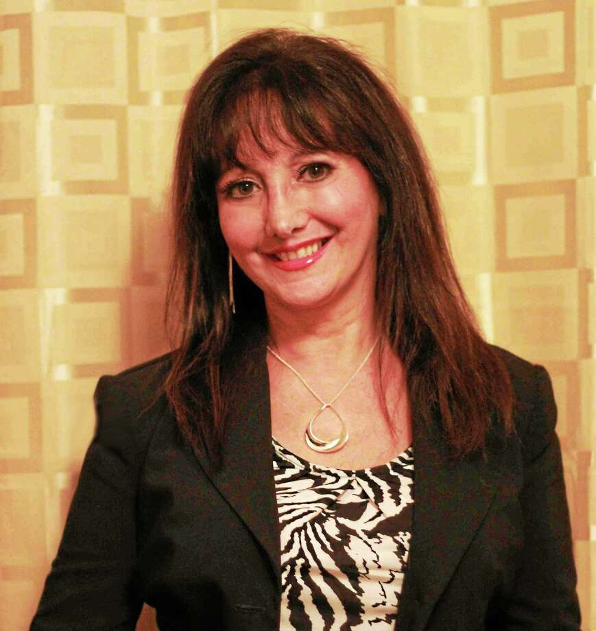 Psychic spirit medium Lisa Lanno will be in touch with lost loved ones Friday night in Branford. She also happens to love animals. Photo: Contributed