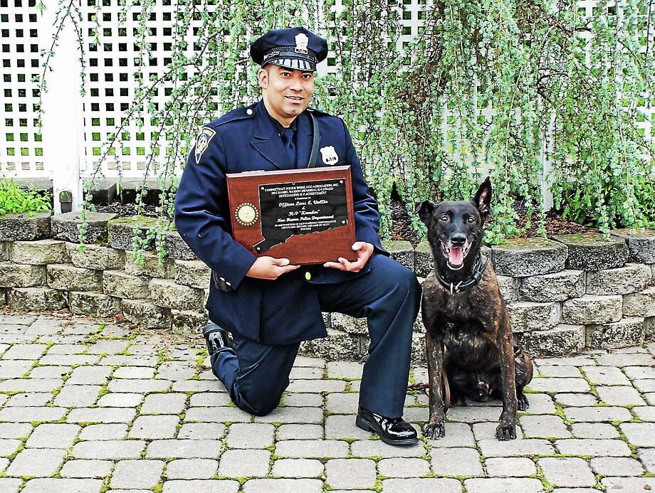 New Haven police dog Xander and Officer Lars Vallin. Photo: Contributed Photo