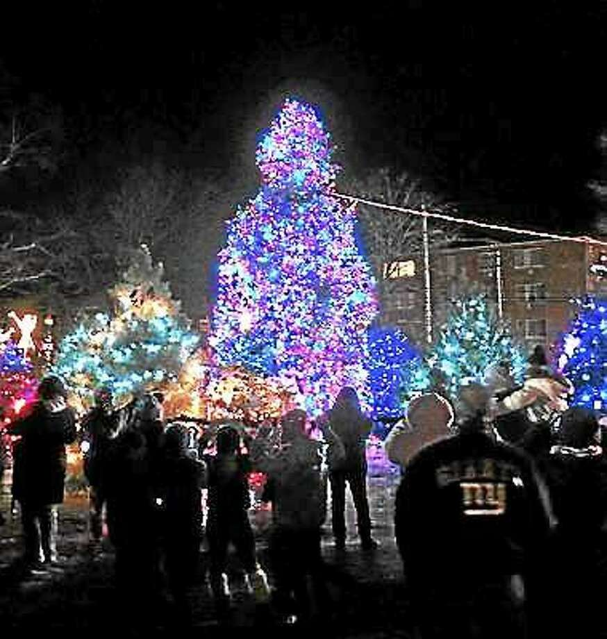 The West Haven Christmas tree is lit on the Green in 2013.  Peter Casolino — New Haven Register file photo Photo: Journal Register Co.