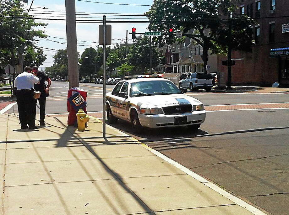 Police investigate after a man was stabbed Monday near Grand and Blatchley avenues in the Fair Haven section of New Haven. Photo: Wes Duplantier — New Haven Register