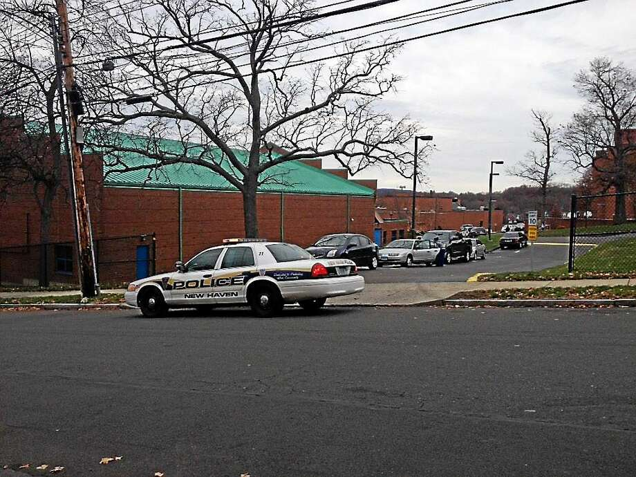 Police outside the Albertus Magnus College campus on Tuesday in New Haven after a threat led to a lockdown. Photo: Evan Lips — New Haven Register