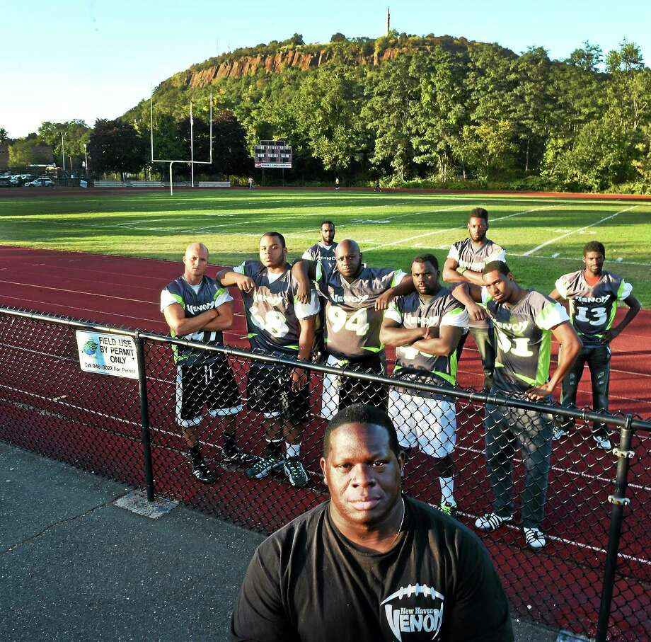 New Haven Venom Football Club head coach Booker McJunkin and members of the team are seen at the Wilbur Cross High School football field earlier this week in New Haven. Photo: Peter Hvizdak — New Haven Register     / ©2014 Peter Hvizdak