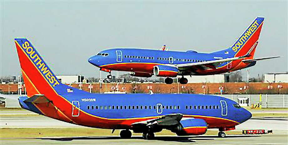 In this Feb. 9, 2012 file photo, a Southwest Airlines Boeing 737 waits to take off at Chicago's Midway Airport as another lands. Photo: Associated Press   / AP2012