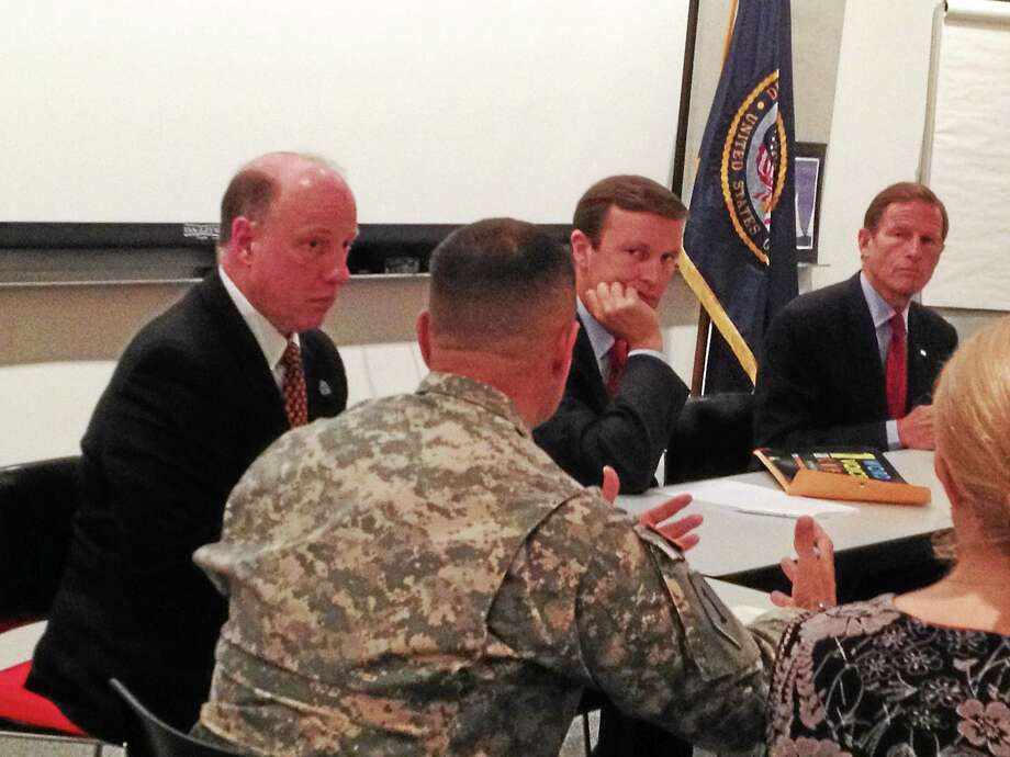 Major J. Alvarado, director of the Connecticut Army National Guard Medical Detachment's Behavioral Health Team (back to camera), talks about veterans' suicides to, from left, VA Connecticut Healthcare System Director Gerald Culliton, U.S. Sen. Chris Murphy, D-Conn., and U.S. Sen. Richard Blumenthal, D-Conn. Photo: Mark Zaretsky — New Haven Register