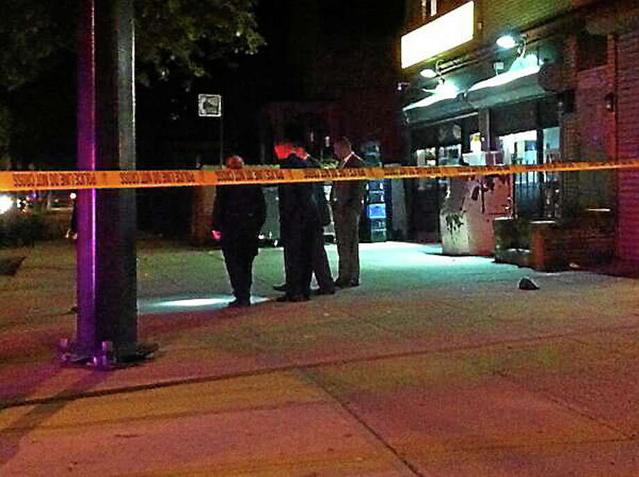 Police investigate near the corner of Howard Avenue and Spring Street Wednesday night. Photo: Keldy Ortiz/New Haven Register