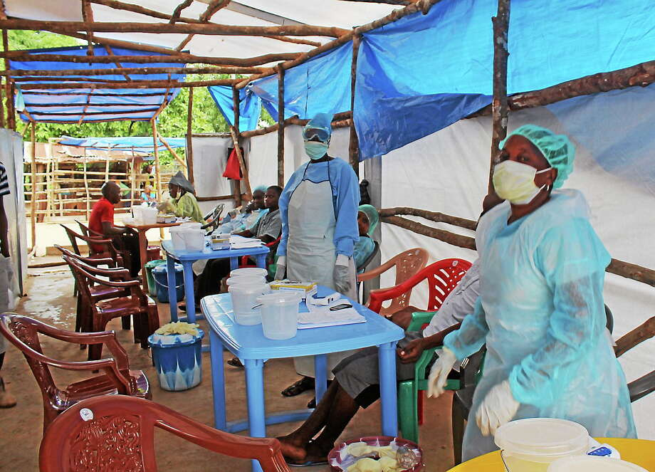 In this photo taken on July 27, 2014, medical personnel inside a clinic take care of Ebola patients in the Kenema District on the outskirts of Kenema, Sierra Leone. Photo: AP Photo/ Youssouf Bah   / AP