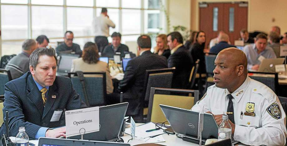 From left, Yale police Assistant Chief of Administration Steven Woznyk and Chief Ronnell Higgins coordinate efforts during a FEMA drill Wednesday in Orange. Photo: Rich Scinto — New Haven Register