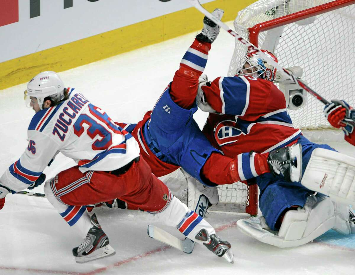 Rangers right wing Mats Zuccarello (36) checks Montreal Canadiens right wing Brian Gionta into Montreal Canadiens goalie Dustin Tokarski during the second period of Game 5 Tuesday.