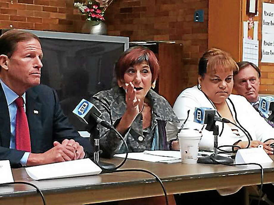 U.S. Rep. Rosa DeLauro, D-3, center, makes a point Monday during a panel discussion of healthcare advocates at the Atwater Senior Citizen Center about the state of Medicare in Connecticut. Photo: Journal Register Co.