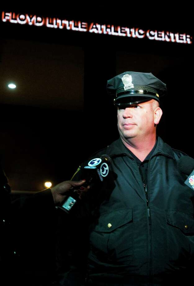 New Haven Police spokesman Officer David Hartman, meets with the press outside of Hillhouse High School, where a 14-year-old boy was shot in January 2013. Photo: Melanie Stengel — New Haven Register File Photo
