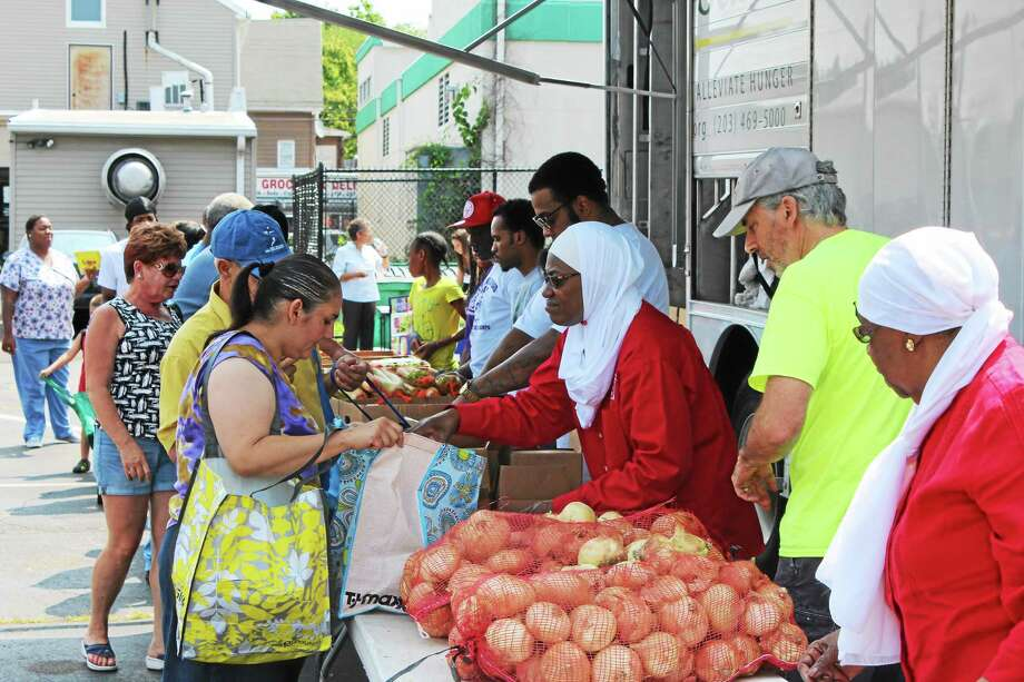 Carolyn El-Amin traveled from Hartford to participate in the local food pantry in Hamden marking the ending of Ramadan. Photo: Journal Register Co.