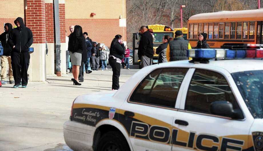 Students return to Wilbur Cross High School in New Haven after being evacuated after a late morning bomb threat Tuesday. Photo: Mara Lavitt — New Haven Register   / Mara Lavitt