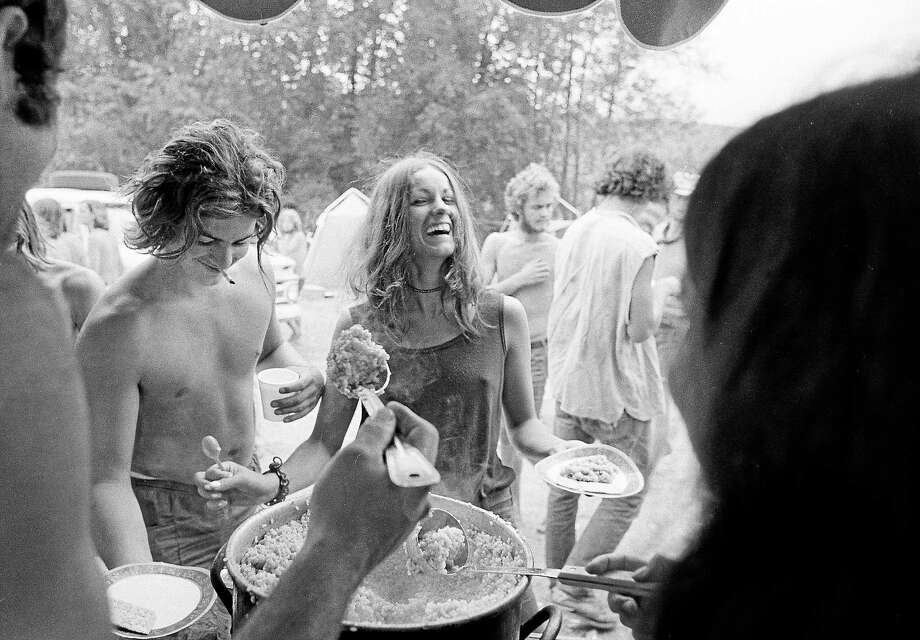 AP file photo  A young man and his girlfriend get food from the free kitchen at the banned Powder Ridge Rock Festival in Middlefield in this Aug. 1, 1970, file photo. Photo: ASSOCIATED PRESS / AP1970