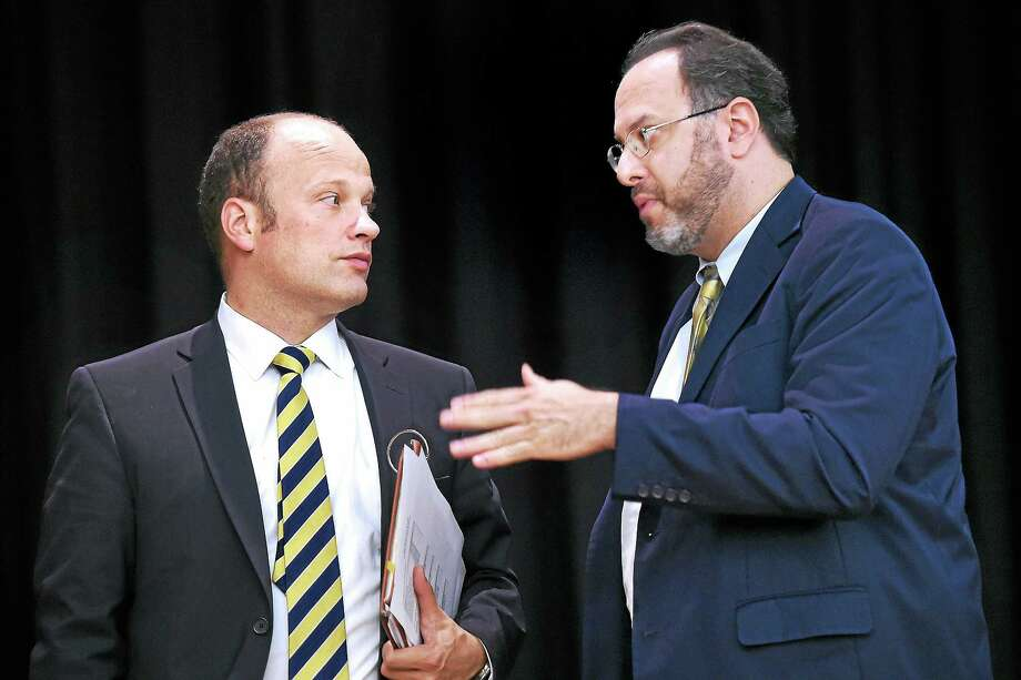 (Arnold Gold-New Haven Register)  New Haven Superintendent of Schools Garth Harries (left) talks with Connecticut Commissioner of Education Stefan Pryor after a press conference announcing school improvement grants at Lincoln-Bassett School in New Haven on 7/28/2014. Photo: Journal Register Co.