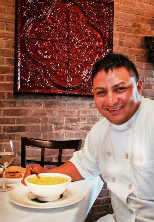 (Melanie Stengel ó New Haven Registe  Mambo Cocina Latina Chef, Alex Morales with a bowl of his Corn Chowder12/26. Photo: Journal Register Co.