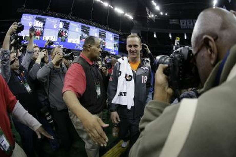 Denver Broncos' Peyton Manning makes his way to a seat for Media Day for Super Bowl XLVIII Tuesday in Newark, N.J.