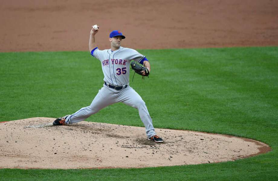 New York Mets starter Dillon Gee delivers a pitch against the Nationals in the third inning of Thursday's afternoon game in Washington. Photo: Nick Wass — The Associated Press   / FR67404 AP