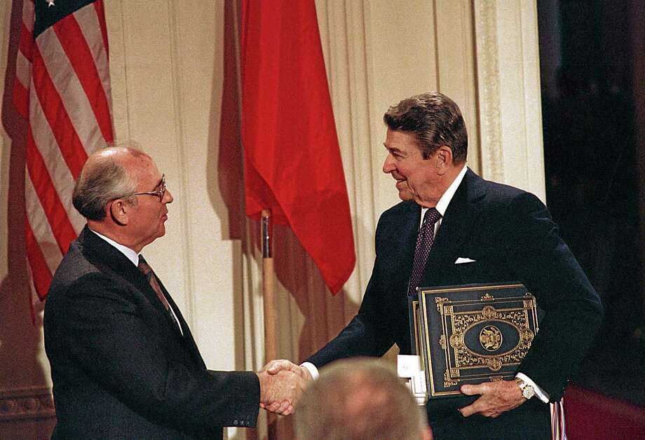 """In this Dec. 8, 1987 file photo, U.S. President Ronald Reagan, right, shakes hands with Soviet leader Mikhail Gorbachev after the two leaders signed the Intermediate Range Nuclear Forces Treaty to eliminate intermediate-range missiles during a ceremony in the White House East Room in Washington. In an escalation of tensions, the Obama administration accused Russia Monday of conducting tests in violation of a 1987 nuclear missile treaty, calling the breach """"a very serious matter"""" and going public with allegations that have simmered for some time. Photo: Associated Press   / AP"""