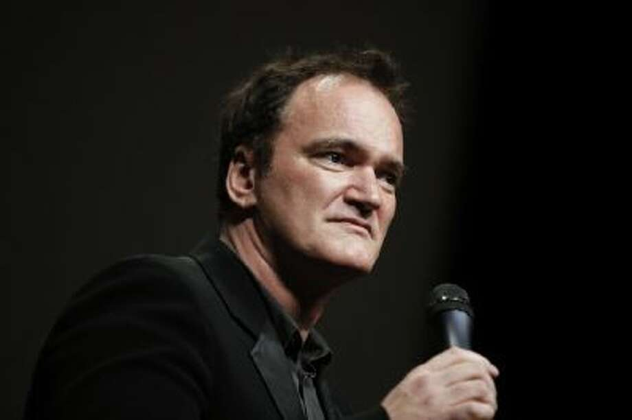 "In this Oct. 18, 2013 file photo, director Quentin Tarantino delivers a speech before receiving the Lumiere Award during the 5th edition of the Lumiere Festival, in Lyon, central France. Tarantino sued Gawker Media LLC on Monday, Jan. 27, 2014, in Los Angeles for copyright infringement over the site's posting of a story that linked to a leaked copy of his script for a planned film called ""The Hateful Eight."""