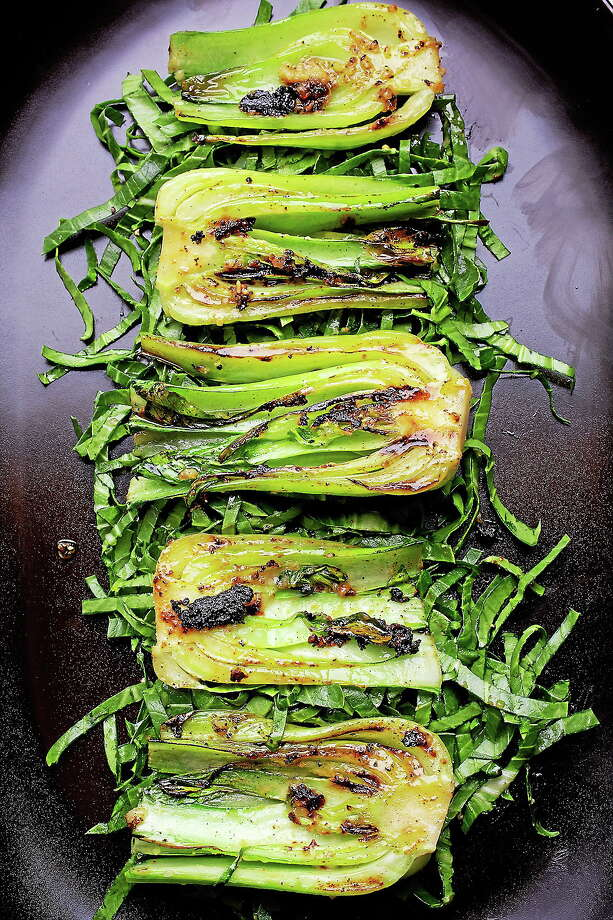 Bok Choy tastes best when it loses its extra water and caramelizes as it does in Grilled Baby Bok Choy With Miso Butter. Photo: Deb Lindsey — For The Washington Post   / Deb Lindsey, © 2014 Deb Lindsey Photography