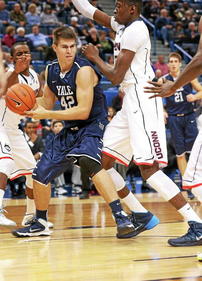 File photo  Yale's Matt Townsend was awarded the Rhodes Scholarship on Saturday. On Sunday, he was back on the court for the Bulldogs scoring the decisive basket in a win over Kent State. Photo: Journal Register Co.